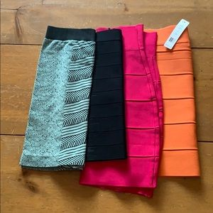 Four pencil skirts two small two medium.
